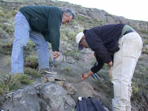 John and Reynaldo excavating a fossil